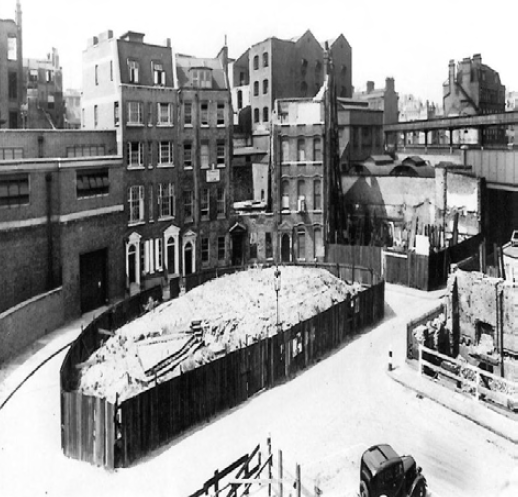 Bomb damage of the Crescent, with spoil-heap in the centre.