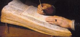 Een man zittend aan een schrijftafel
